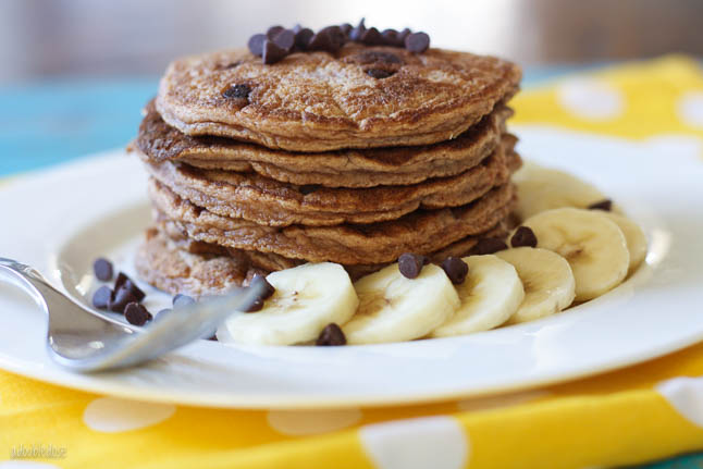 Banana Chocolate Chip Pancakes - the fluffiest, gluten free pancakes stuffed with warm chocolate chips and topped with sliced banana | adoubledose.com