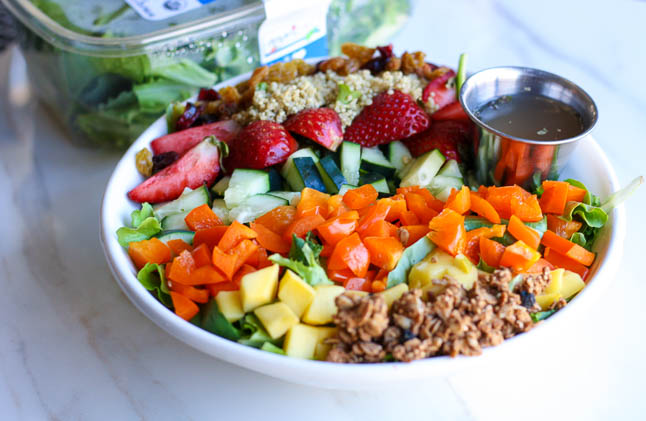 Strawberry Mango Crunch Salad - a crisp, spring salad filled with mango, fresh strawberries, quinoa, crunchy granola, and crisp veggies | adoubledose.com